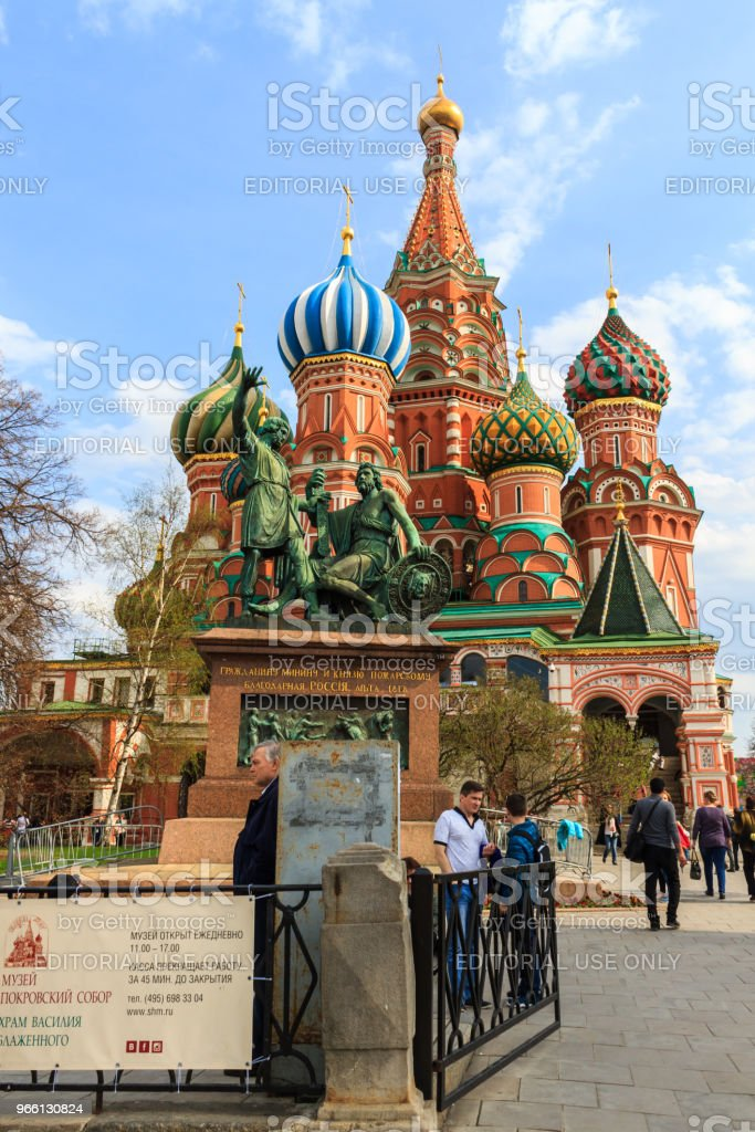 Tourists visit Saint Basil's Cathedral in Red Square at Moscow, Russia. - Стоковые фото Архитектура роялти-фри