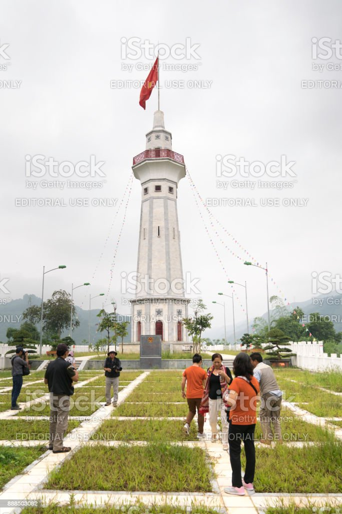 Tourists visit the national flagpole on the border with China Located in the Y Ty River, Lao Cai Province, Vietnam. stock photo