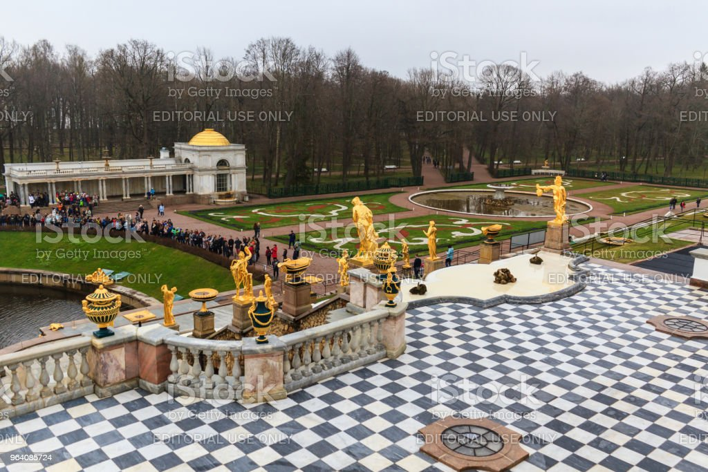 Tourists visit The Peterhof Palace garden. - Royalty-free Antique Stock Photo