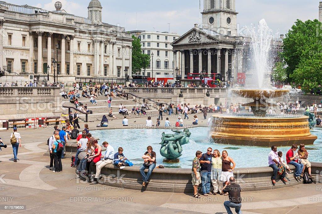 Tourists visit Trafalgar Square. London, UK stock photo