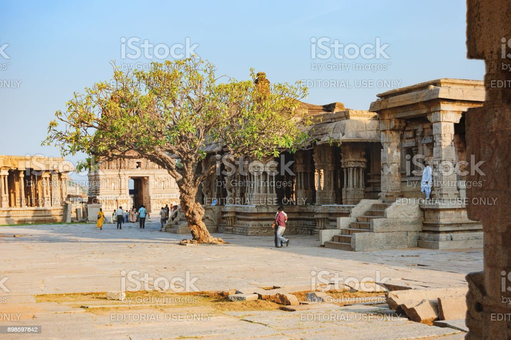 Tourists visit Vitthala Temple in Hampi, India stock photo