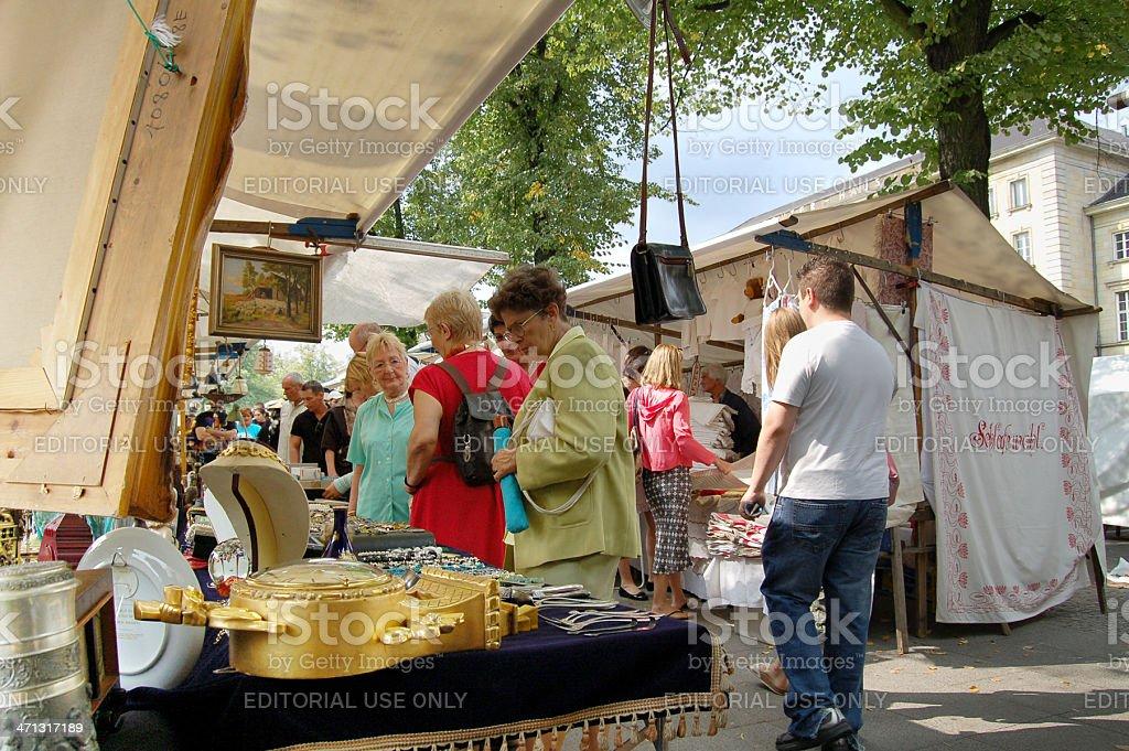tourists visiting big Flea Market in Tiergarten Berlin . Its located...