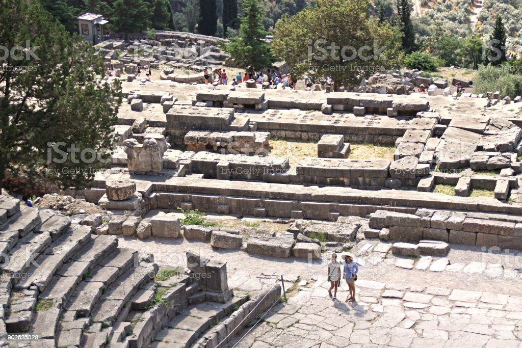 Tourists visiting Delphi amphitheater and Apollon temple, Delphi, Greece stock photo