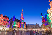 Brussels, Belgium - May 13, 2015: Tourists visiting famous Grand Place (Grote Markt) the central square of Brussels. The square is the most important tourist destination and most memorable landmark in Brussels.
