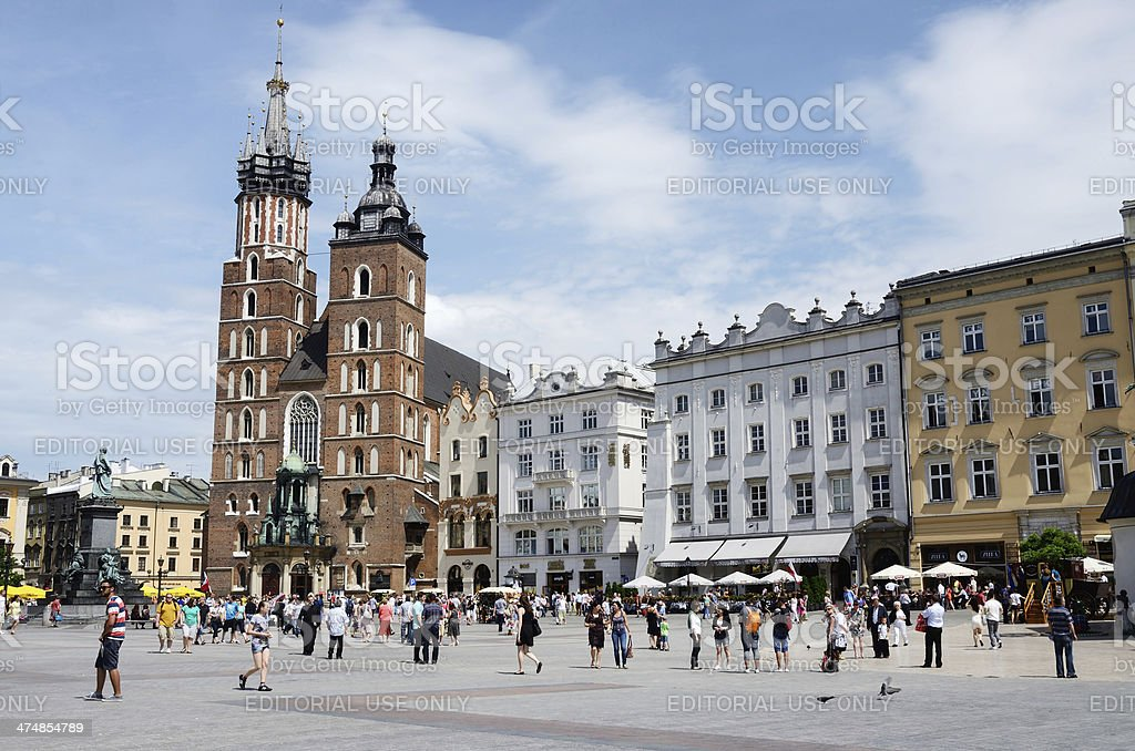 Tourists visiting market square,St. Mary Church,Krakow stock photo
