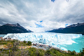 Large group of tourists visit the famous Perito Moreno Glacier in Los Glaciares National Park, Patagonia, Argentina