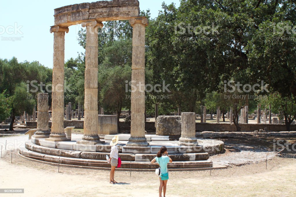 Tourists visiting Philippeion at ancient Olympia, Greece stock photo