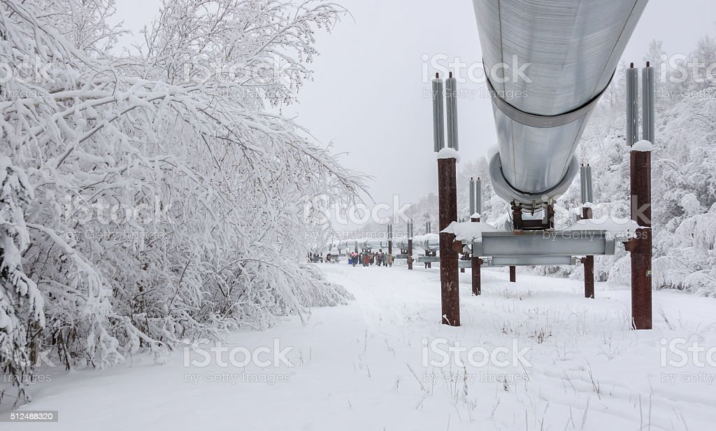 Tourists Visiting Pipeline in Winter stock photo