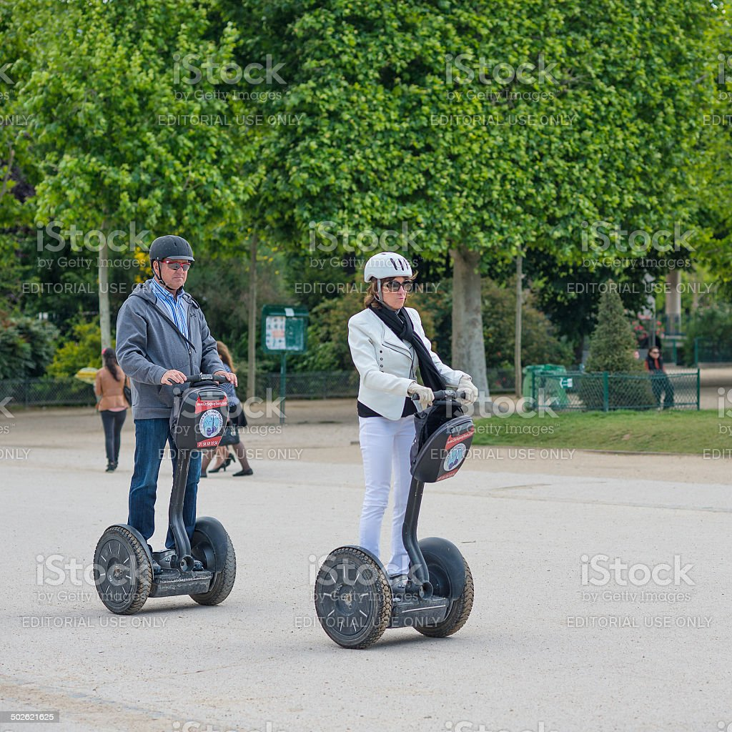 Tourists visiting the city near the Eiffel Tower. stock photo
