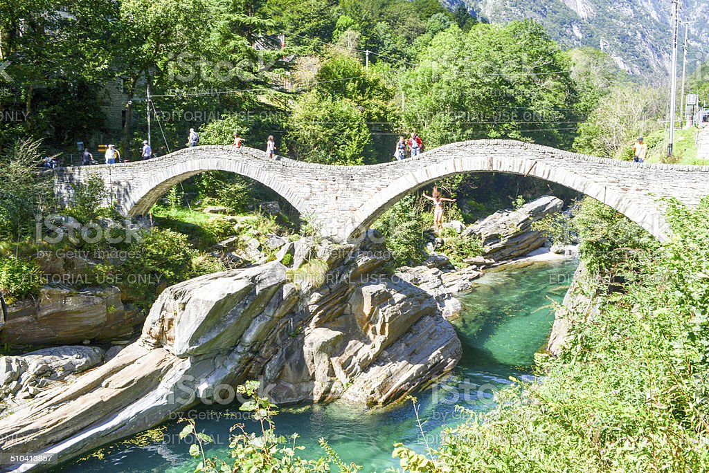 Tourists visiting the famous roman bridge at Lavertezzo stock photo