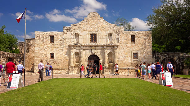 tourists visiting the historic alamo in san antonio, texas - the alamo stock photos and pictures