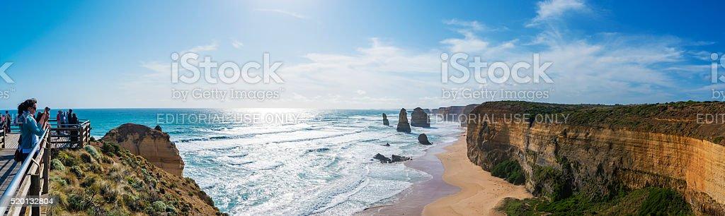 Tourists visting the Twelve Apostles in Australia stock photo