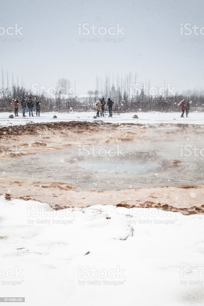 Tourists waiting for eruption of Geysir, Iceland royalty-free stock photo