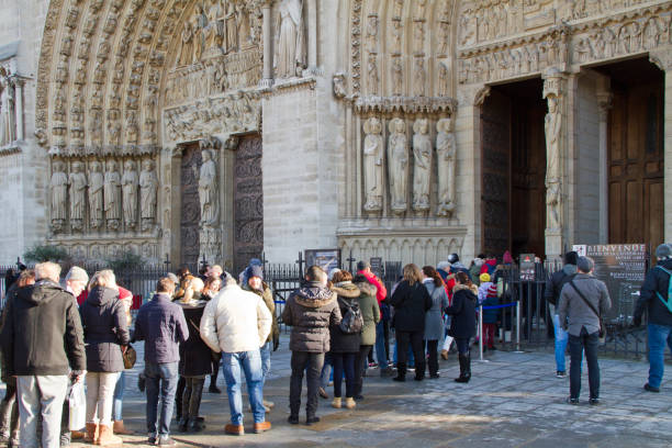 Tourists waiting in line to visit Notre Dame de Paris cathedral stock photo