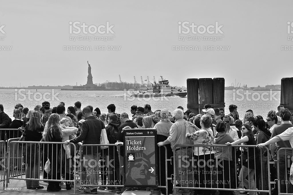 Tourists waiting to board Statue of Liberty ferry boat, NYC royalty-free stock photo