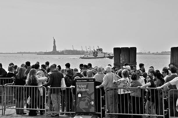 Tourists waiting to board Statue of Liberty ferry boat, NYC stock photo