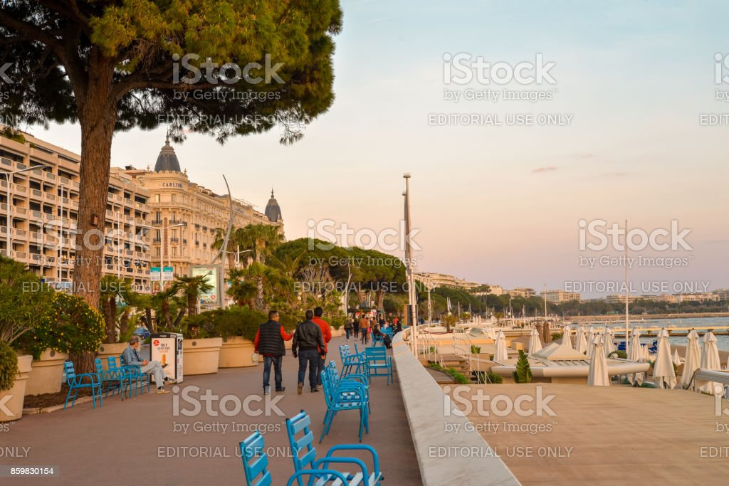 Tourists walk along famous Promenade de la Croisette stock photo