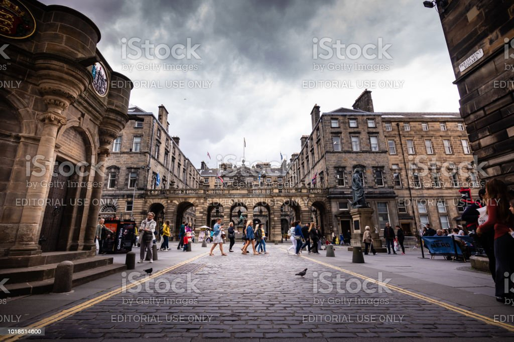 Tourists walk along Royal Mile in Edinburgh, Scotland stock photo