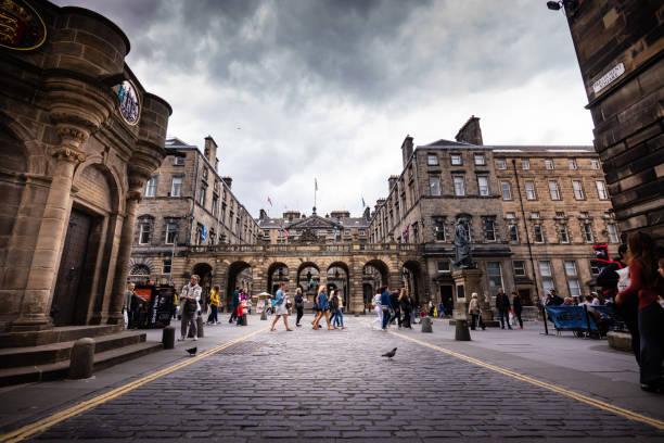 Tourists walk along Royal Mile in Edinburgh, Scotland stock photo