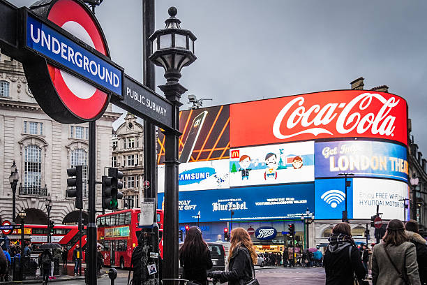 Tourists walk around Piccadilly Circus, London, at Christmas time stock photo