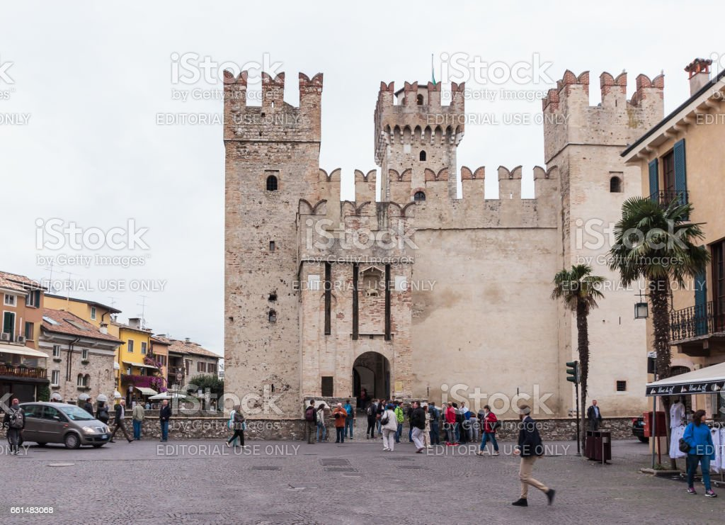 Tourists walk around the Piazza Castello in Sirmione stock photo
