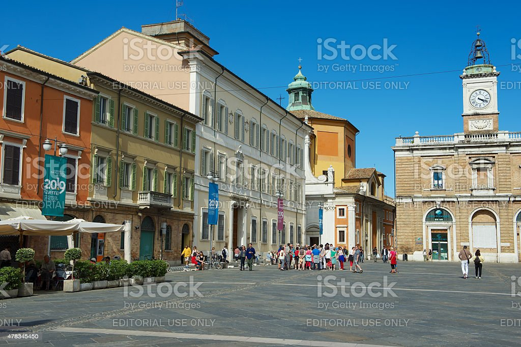 Tourists walk by the square in Ravenna, Italy. stock photo