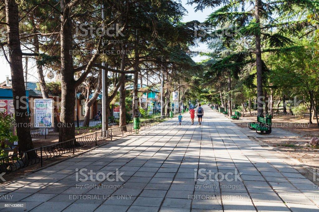 tourists walk in urban park in Alushta city stock photo