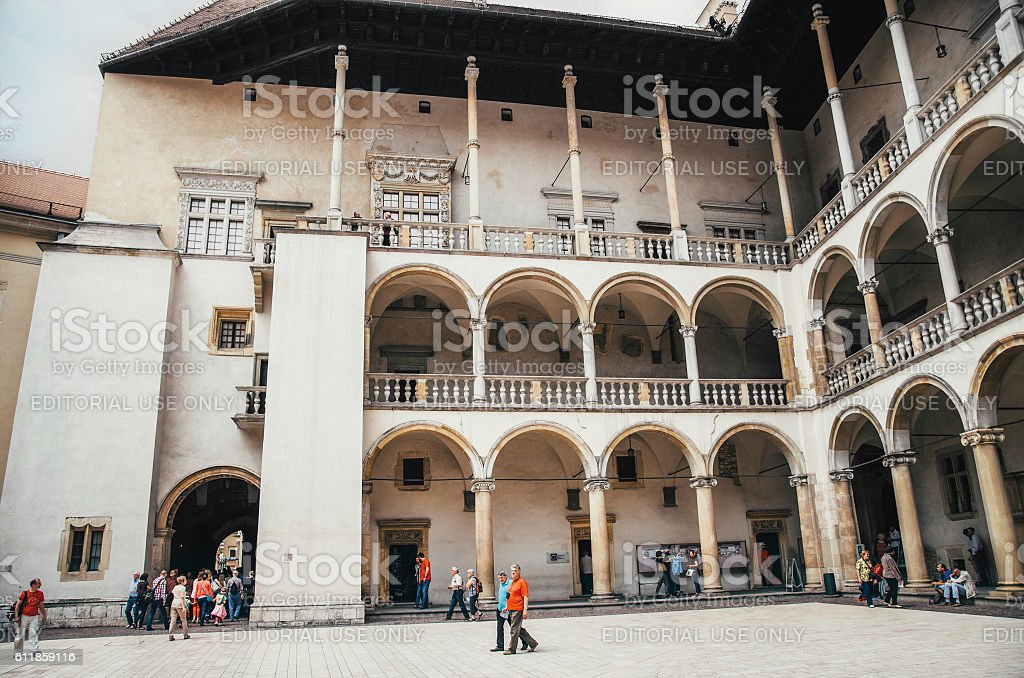 Tourists walk on courtyard of Royal Wawel Castle stock photo