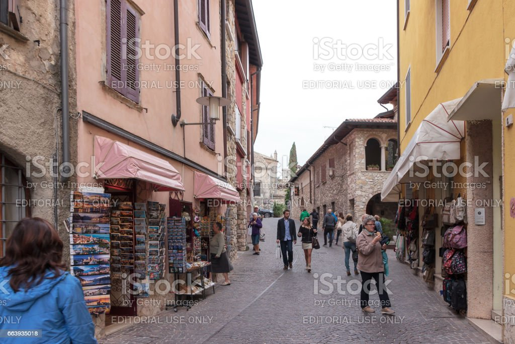Tourists walk the streets and inspect local attractions in Sirmione stock photo
