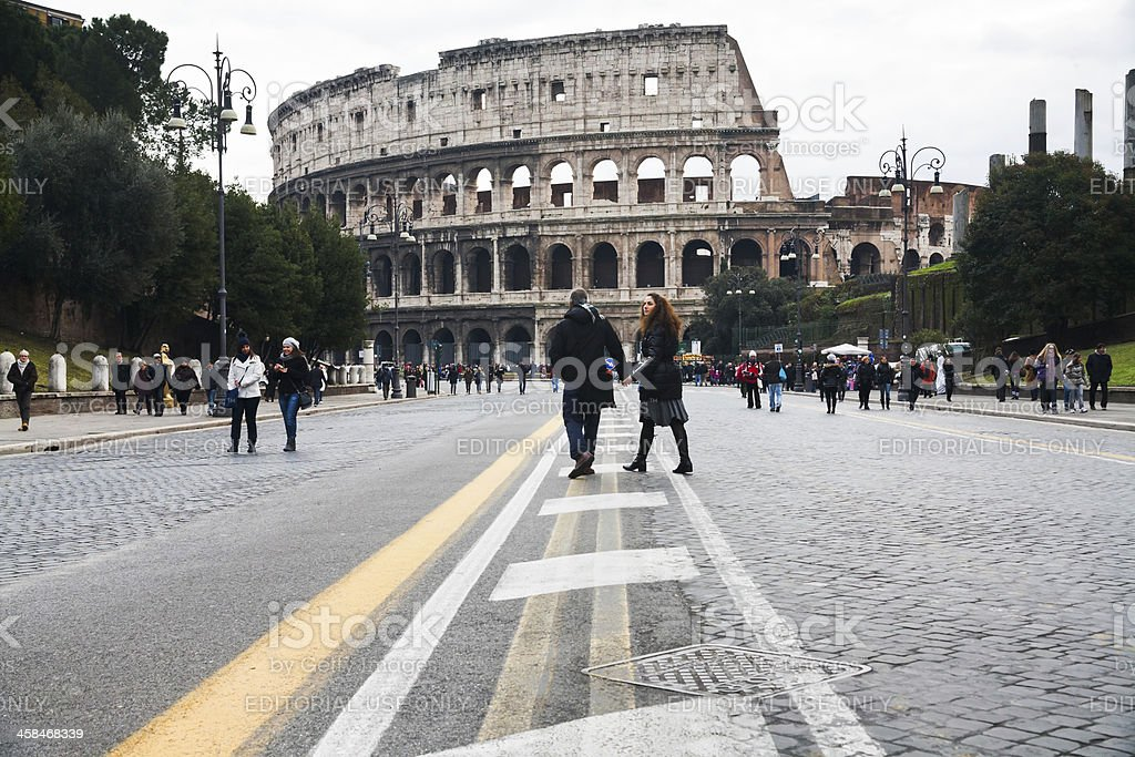 tourists walk to Colosseum in Rome royalty-free stock photo