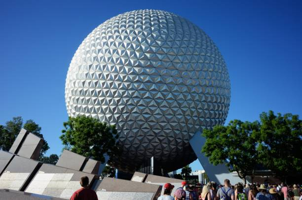 Tourists walk toward Spaceship Earth at Epcot stock photo