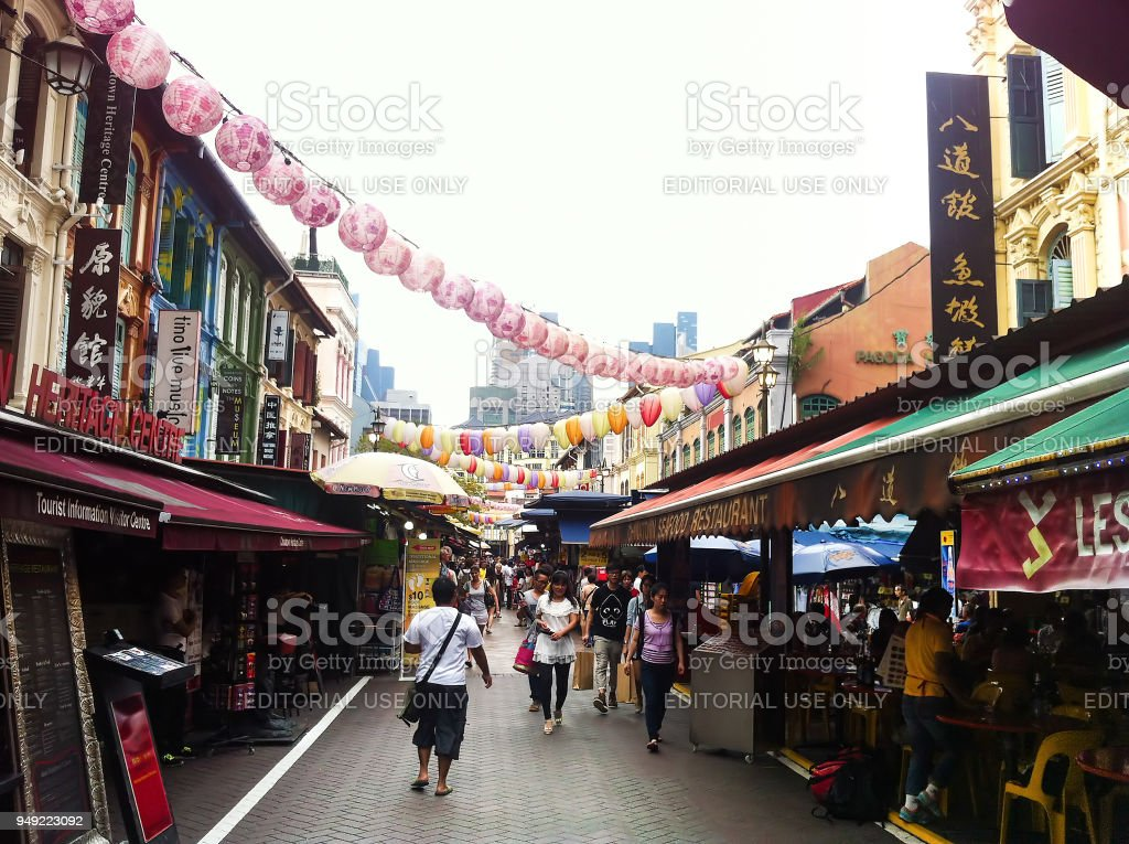 Tourists walking, and shopping at traditional Chinatown market place in Singapore stock photo
