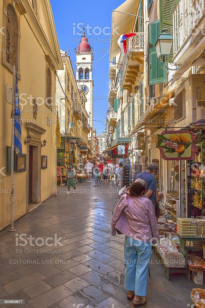 Tourists walking and shopping on narrow streets stock photo
