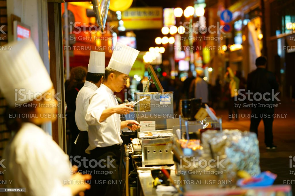 Restaurant and store signs in the Dotonbori District. The area is a...