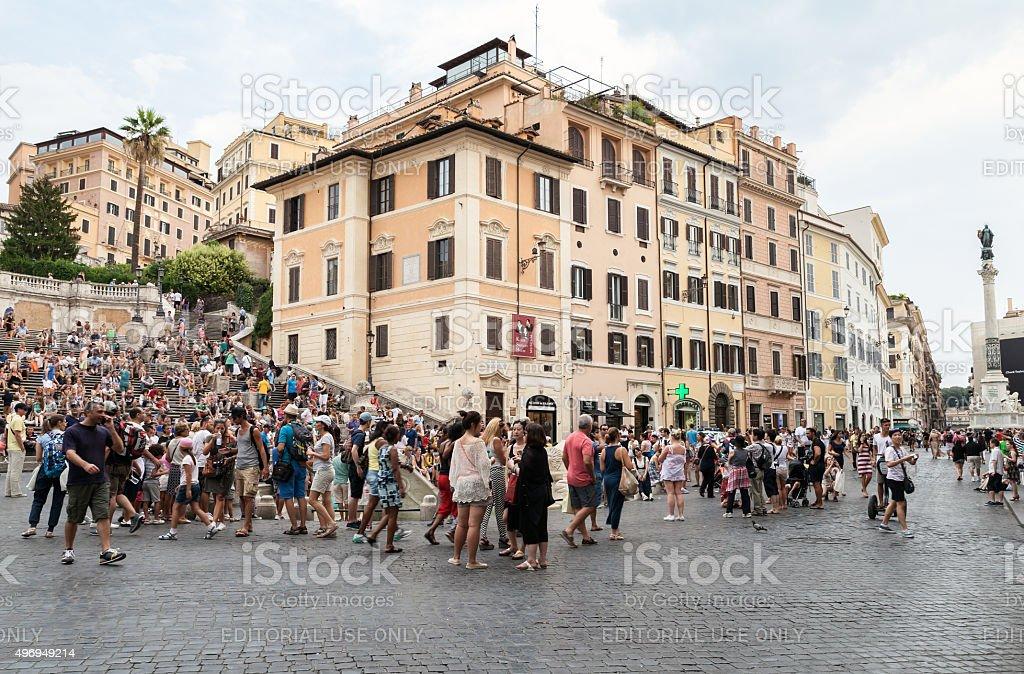 Tourists walking around Fontana della Barcaccia stock photo