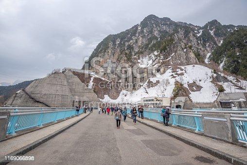 Toyama, Japan - April 21, 2019 : Unidentified tourists walking at  Kurobe Dam on Tateyama Kurobe Alpine Route, Toyama, Japan.