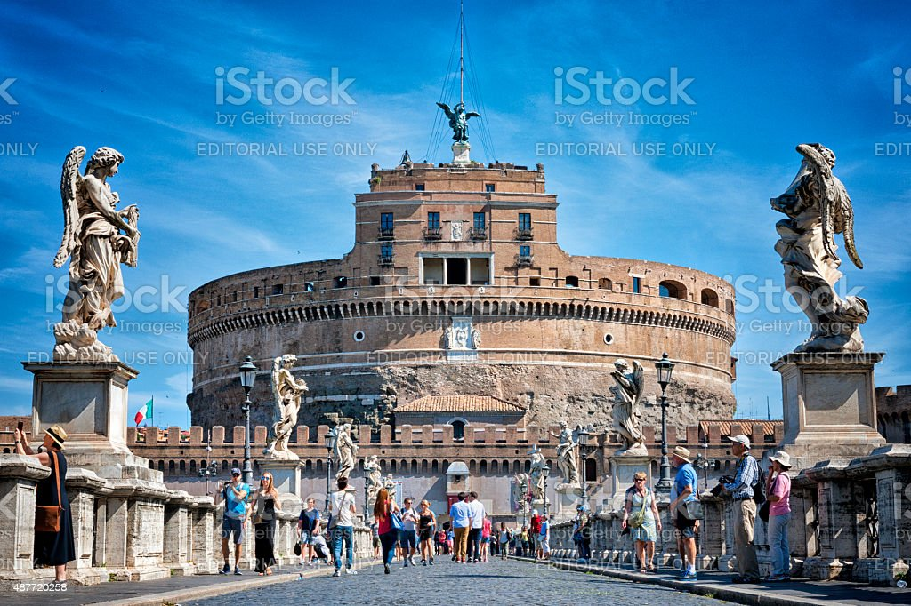 Tourists walking by Castel Sant'Angelo in Rome, Italy stock photo