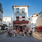Paris, France - May 15, 2014: Le Consulat a typical cafe in Montmartre area, some tourists have relax in the terrace of the bar drinking something.