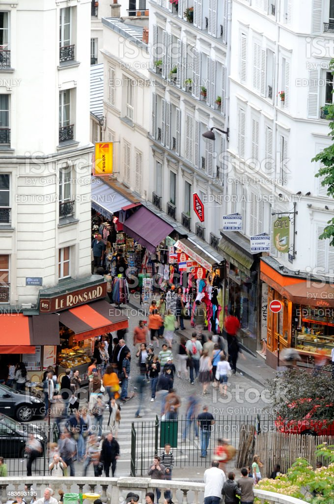tourists walking in Montmartre at dusk, Paris France royalty-free stock photo