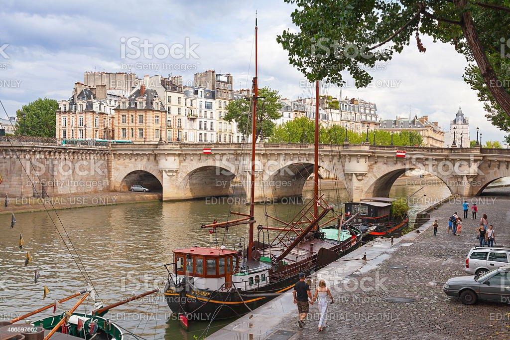 Tourists walking near by Pont Neuf, Paris stock photo