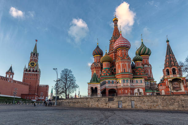 Tourists walking near Kremlin and St Basil's Cathedral in Moscow stock photo