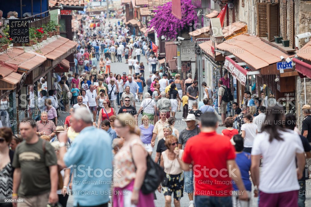 Tourists walking on main street in town of Side Antalya stock photo