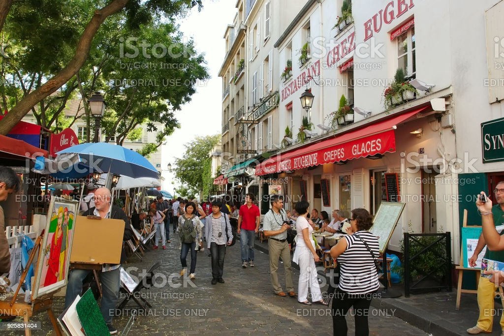 Tourists walking on Montmartre. stock photo