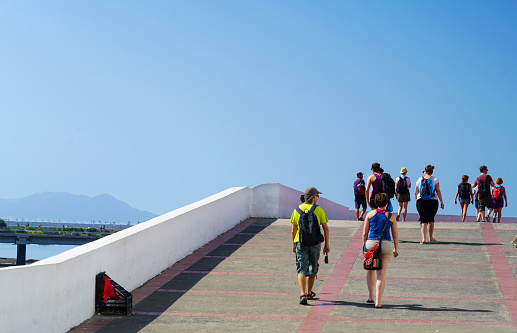 Tourists walking on promenade of the historic district known as Casco Viejo Casco Antiguo in Panama City