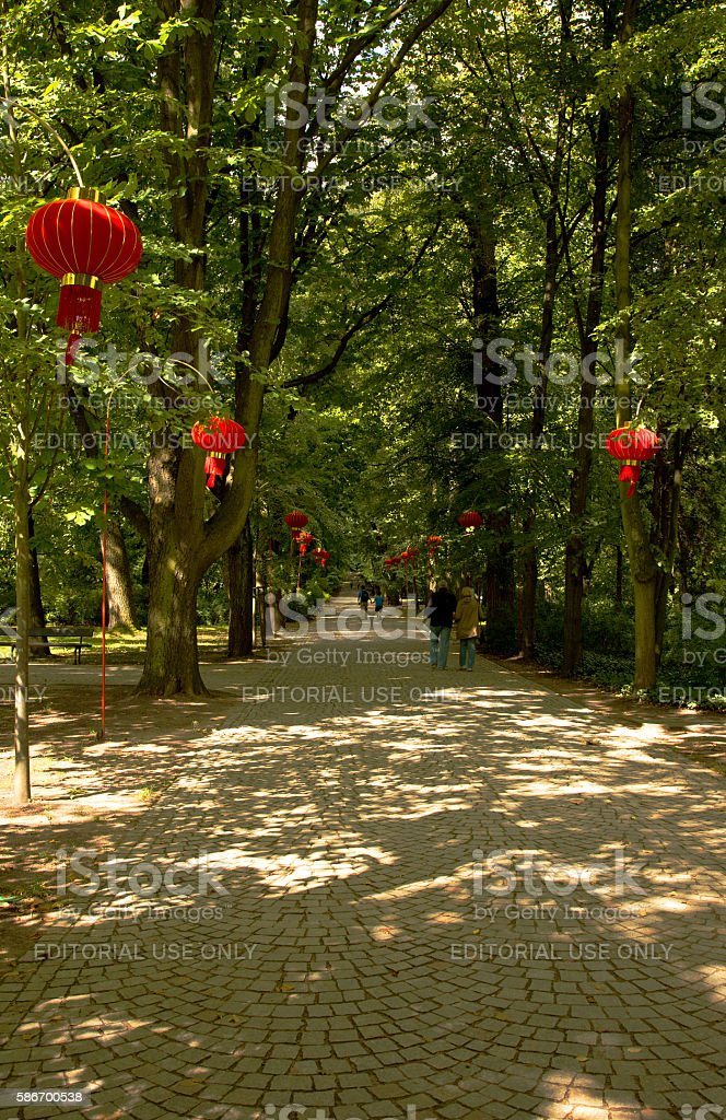 Tourists walking on the alley in the Lazienki Royal Park stock photo