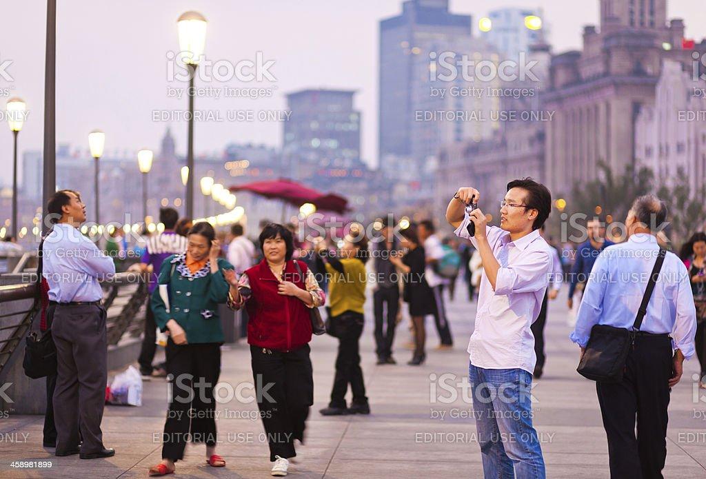 Tourists walking on the Bund, Shanghai royalty-free stock photo