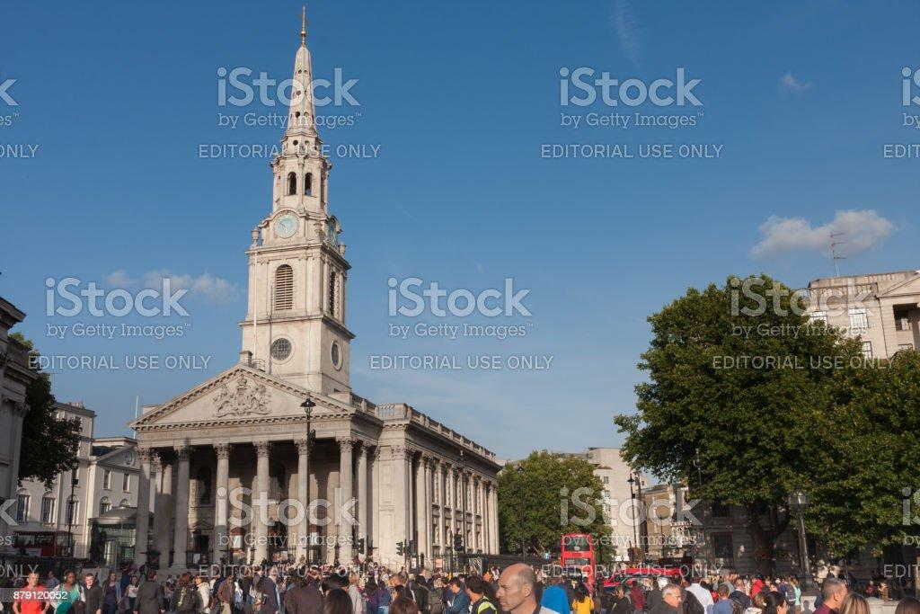 Tourists walking on Trafalgar  Square, stock photo