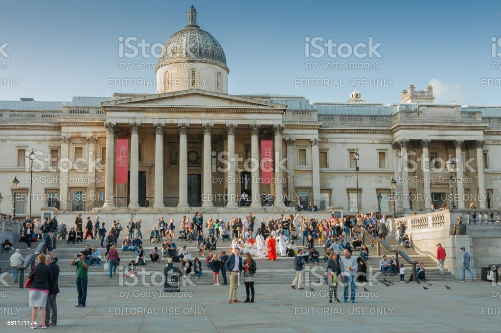 Tourists walking on Trafalgar Square stock photo
