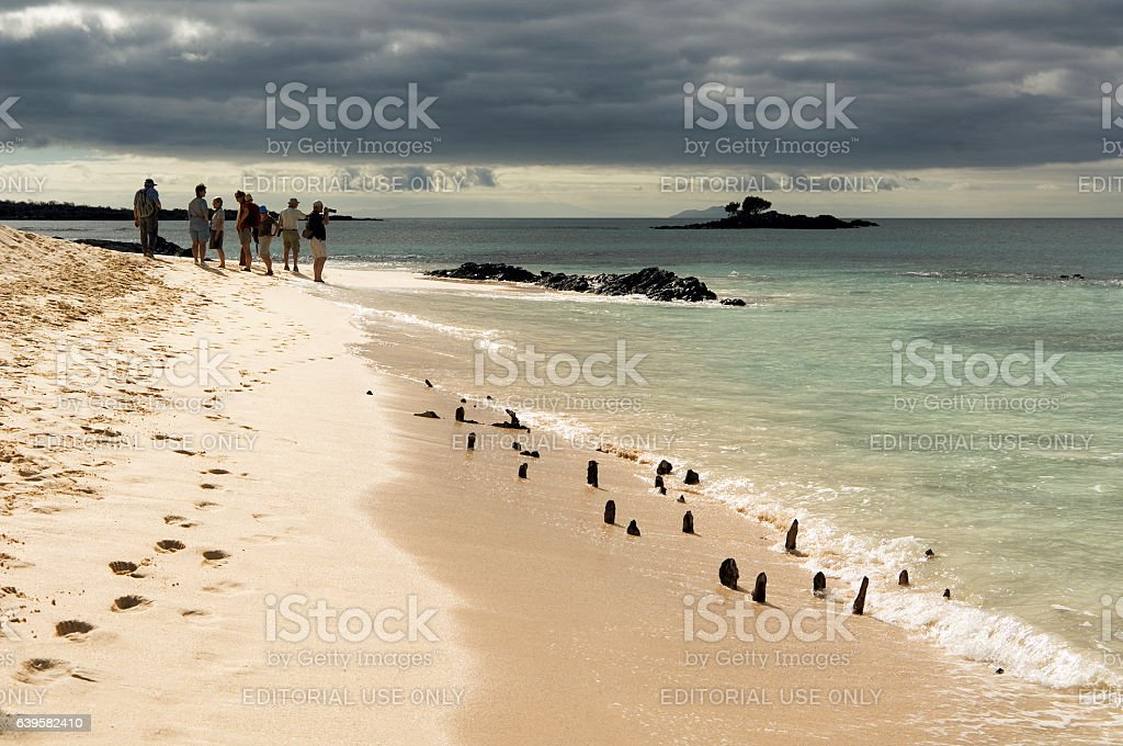 Tourists walking past WWII American landing vessel, Galapagos Islands stock photo