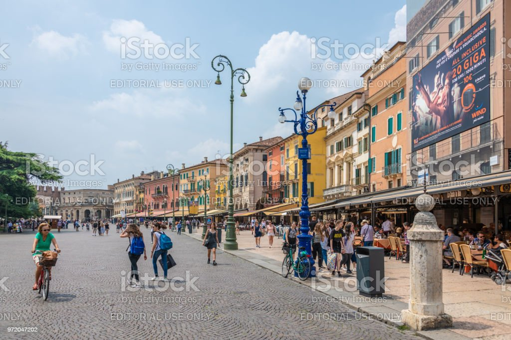 Tourists walking the central square of old town Verona, Italy stock photo